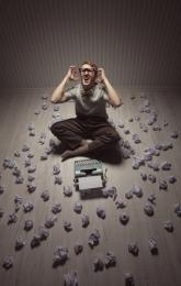 Frustrated man at typewriter