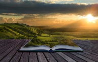 Book in dramatic sunset landscape