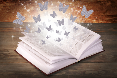 book with butterflies taking flight from its pages