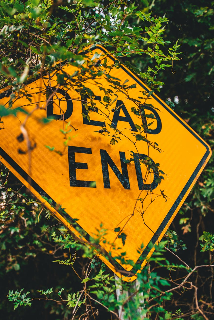 These scams are dead ends! Dead end sign!